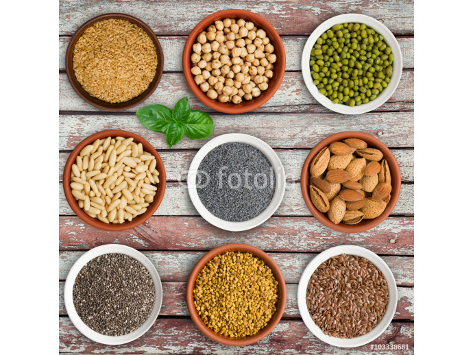 Large seed super food selection in bowls on a wooden background 64238