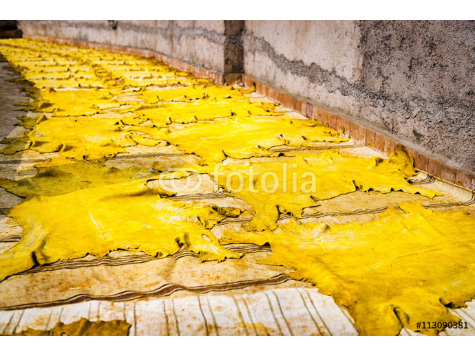 Fototapeta Yellow tinted leather drying in the sun in a tannery in Fez, Morocco 64238