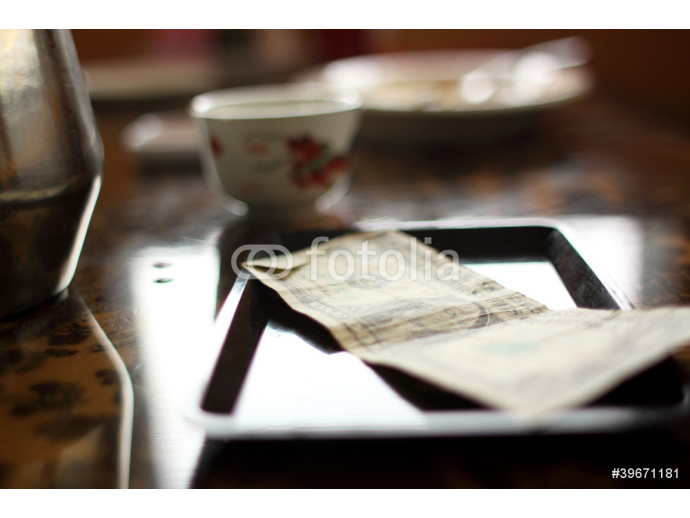 Fototapeta Cash tip on table at a Chinese restaurant. 64238