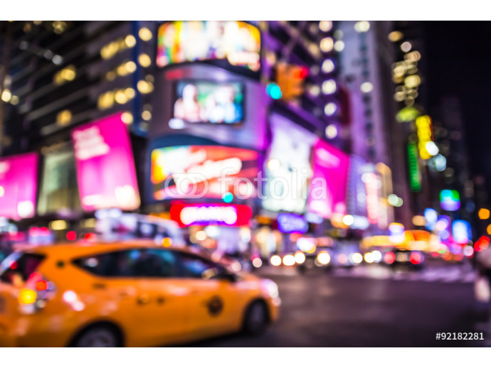 Defocused blur of Times Square in New York City with lights at night and taxi cab 64238