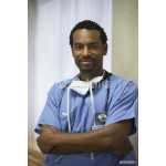 African male surgeon with arms crossed 64238