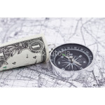 one-dollar bill and a compass lying on a map 64238