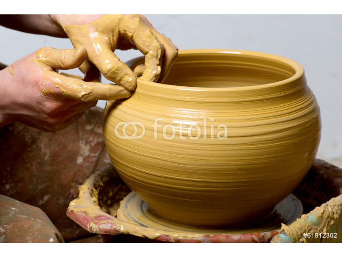 hands of a potter, creating an earthen jar 64238