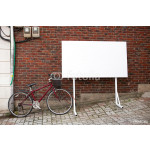 Blank advertisement board at street with bicycle next to it 64238