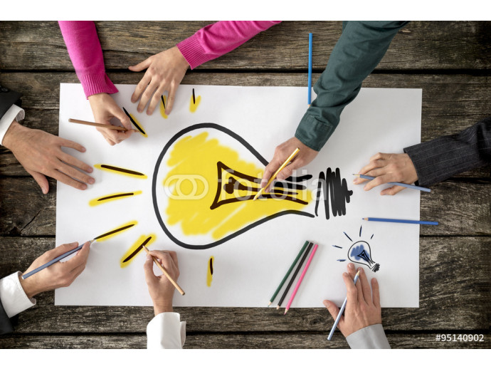 Six people, men and women, drawing bright yellow light bulb on a 64238