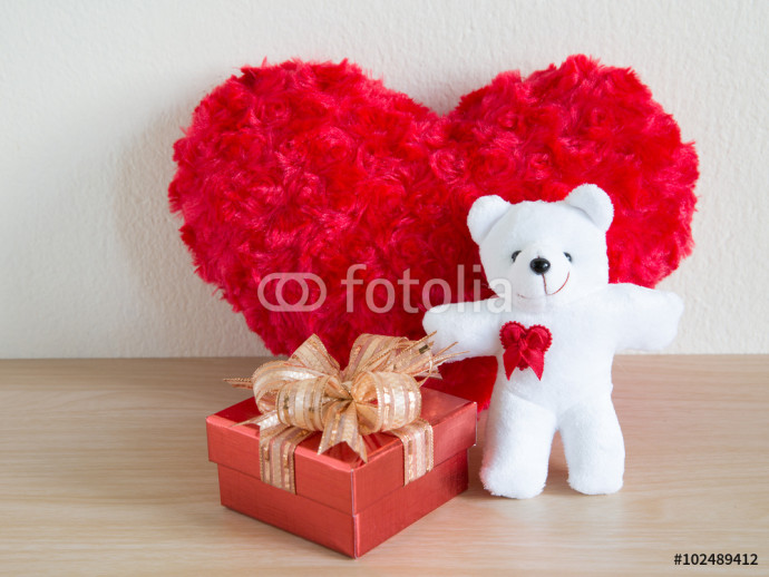 Fluffy red heart and happy white teddy bear and red gift on wooden background 64238
