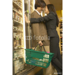 Asian couple hugging at grocery store 64238