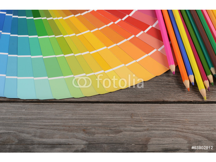 Color palette on the wooden background 64238