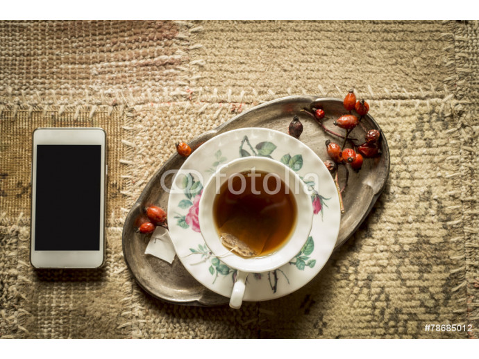 Vliestapete Top view of smartphone and cup of tea 64238