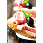 Sandwiches with prosciutto olive on plate 64238