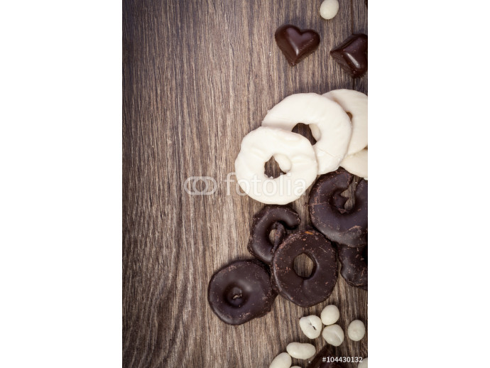 Chocolate and heart shaped desert on wooden background 64238