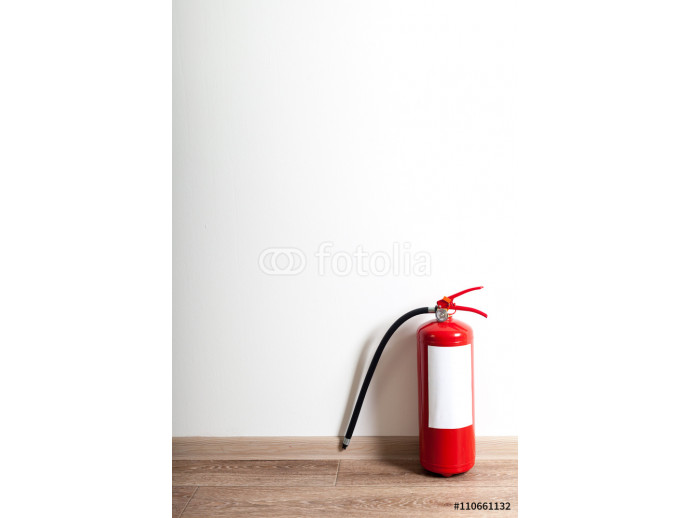 Fire extinguisher near white wall, ready for use 64238