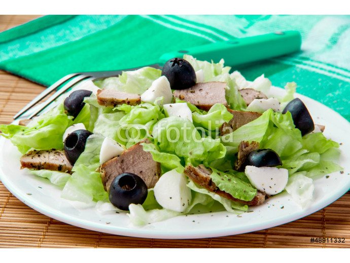 Fresh salad with lettuce, meat and olives 64238