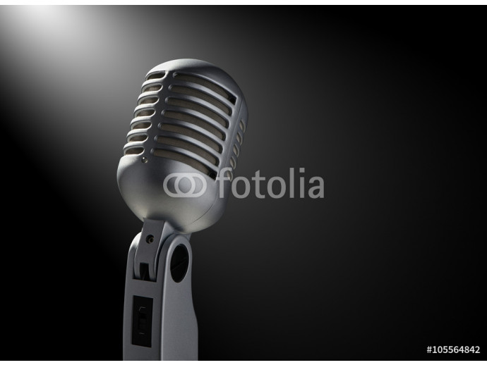 Vintage microphone on black with highlights 64238