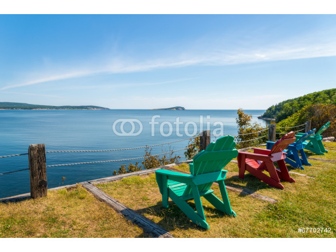 Colorful lounge chairs with a view of beautiful scenic panorama 64238