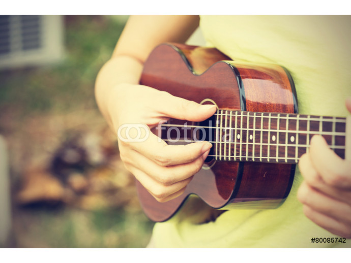 Woman playing ukulele, vintage style. 64238