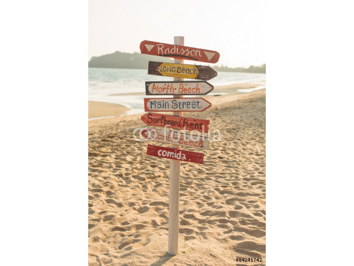 Signpost made of wood with the on the tropical beach. 64238