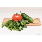 Fresh tomato, cucumber, parsley and dill on the cutting board 64238