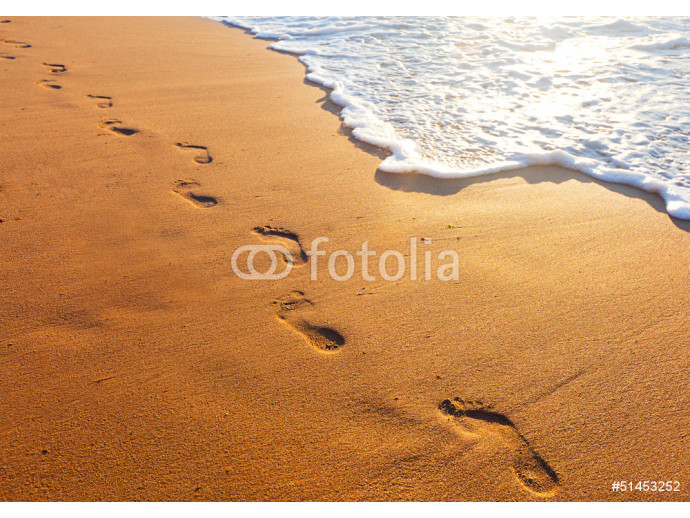 beach, wave and footsteps at sunset time 64238