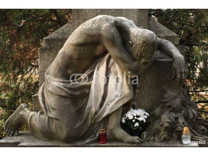 Mourning nude man. Old tombstone at the Kerepesi Cemetery in Bud 64238
