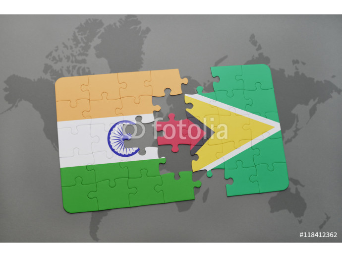 Vliestapete puzzle with the national flag of india and guyana on a world map background. 64238