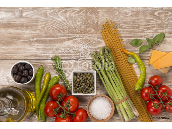 Fresh organic pasta, asparagus, tomatoes, peppers, olives, capers, olive oil, parmesan cheese  ingredients on wood surface  64238