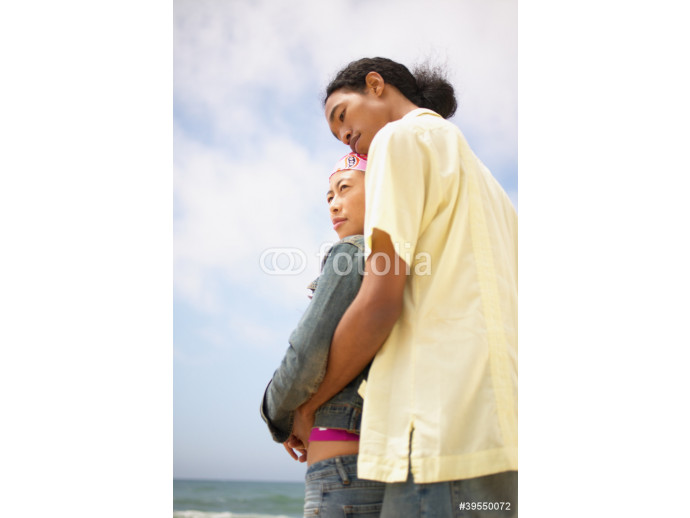 Couple hugging at beach 64238