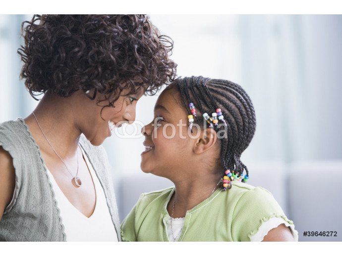 African American mother and daughter smiling at each other 64238