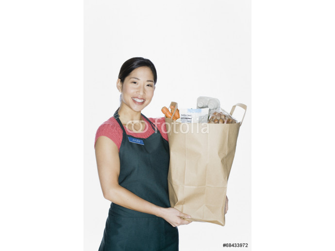 Asian woman wearing apron and holding grocery bag 64238