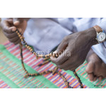 Hands of a Muslim man praying with rosary beads 64238
