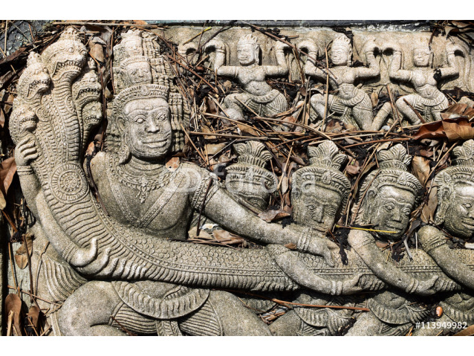 Abandoned Stone Wall Carving Of religious legend in buddha temple at southeast asia with vintage filter background 64238