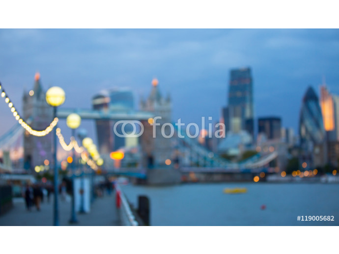 Blur background. London at sunset, panoramic view of modern skyscrapers and city lights