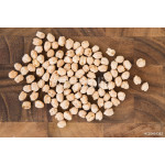 White chick peas or safed chana spilled over a wooden board 64238