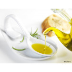 virgin olive oil pouring in a spoon 64238