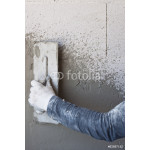 Construction site - Worker performs internal plaster 64238