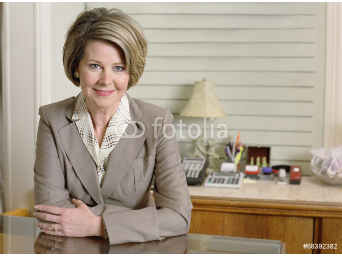 Middle-aged businesswoman smiling for the camera 64238