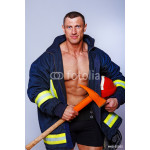 Portrait of handsome fireman posing on white background 64238
