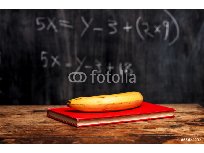 banana and book by blackboard with equation 64238