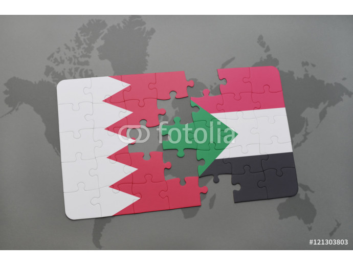 Vliestapete puzzle with the national flag of bahrain and sudan on a world map background. 64238