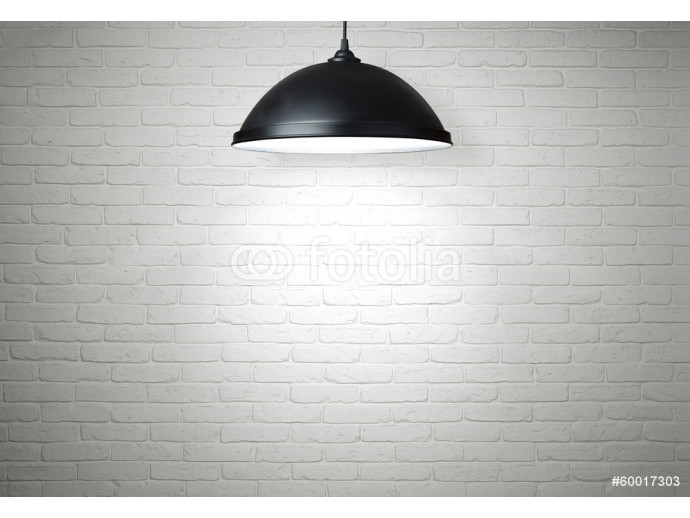 White brick wall illuminated by the lamp with copy space 64238