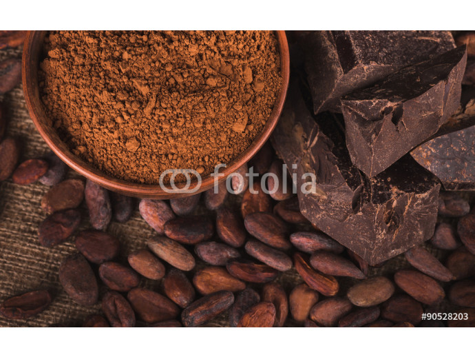 Raw cocoa beans, clay bowl  with cocoa powder, chocolate on sack 64238