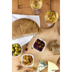 Wine and cheese arrangement on wooden background 64238