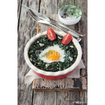 Fresh baked egg with spinach and tomato.Wooden background. 64238