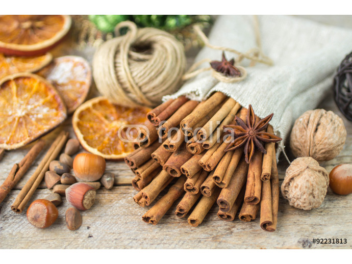 Cinnamon sticks, star anise and nuts on an old wooden table 64238