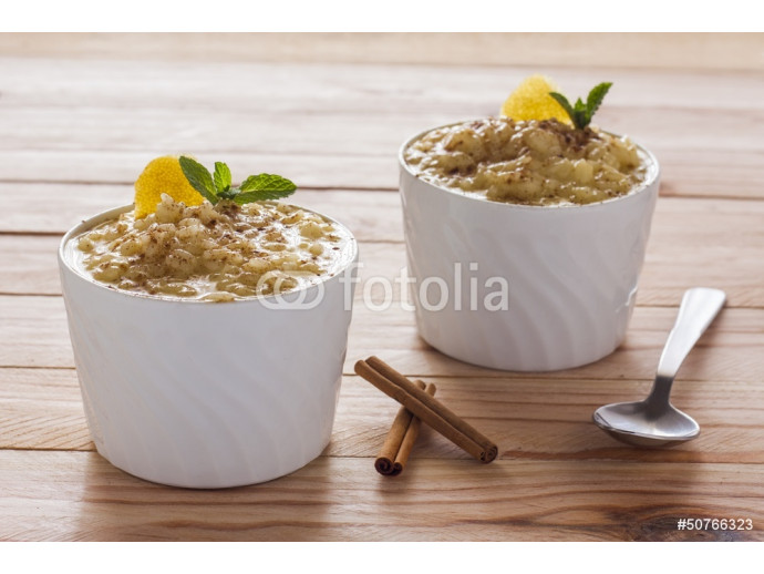 Creamy rice pudding sprinkled with cinnamon 64238
