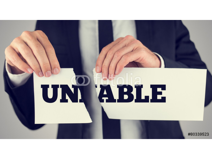 Man holding a torn paper sign in his hands with the words - Un - 64238
