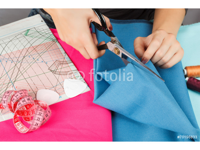hands of a seamstress at work. 64238