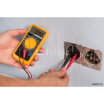 Person Hand Checking Socket Voltage 64238