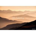 Landscape view of misty mountain hills at sunset 64238