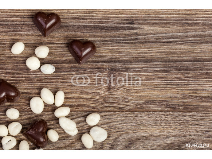 Heart shaped chocolate on vintage wooden background 64238